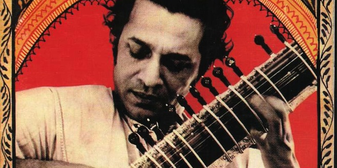 A young Ravi Shankar playing the sitar
